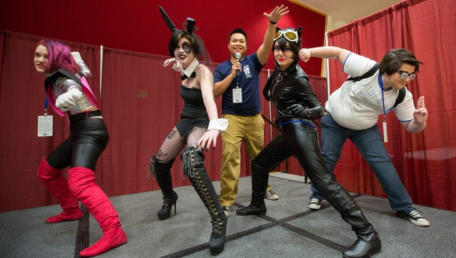 "Jonathan Annua conducts a ""pose off"" between contestants Micah Glidewell as character Mettaton Ex, left, Tegan Wills as Domino, Brandi Lucero as Catwoman and Angeles McClarin as Eyebrow Kid during the Anime Days festival at NMSU's Corbett Center Student Union on Saturday."