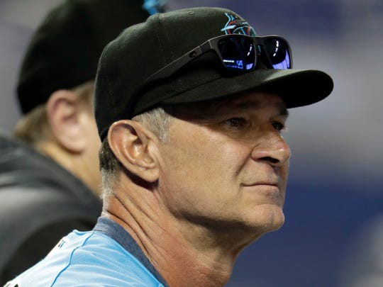 FILE - In this April 19, 2019, file photo, Miami Marlins manager Don Mattingly watches batting practice before a baseball game against the Washington Nationals in Miami. The Marlins are assured of their 10th consecutive losing season, but even by the franchise's standards, this season's record is bad. (AP Photo/Lynne Sladky, File)
