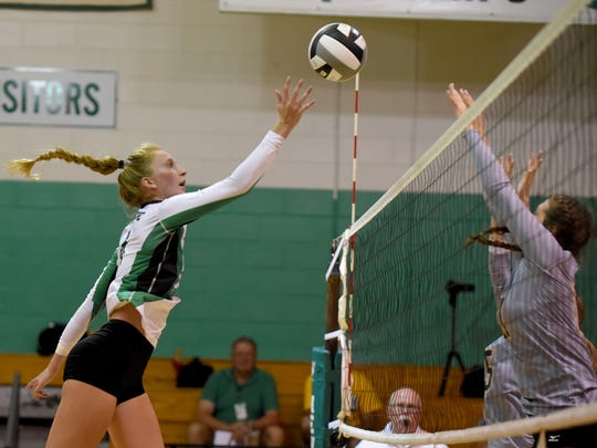 Newark Catholic's Sam Basham tips the ball past a Hamilton Township defender during the annual preview games on Monday at Newark Catholic.