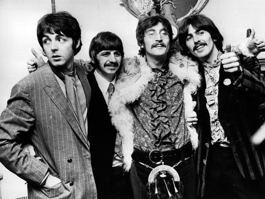 """The Beatles (from left: Paul McCartney, Ringo Starr, John Lennon and George Harrison) celebrate the completion of their album, """"Sgt. Pepper's Lonely Hearts Club Band"""" at a press conference held at the west London home of their manager, Brian Epstein. in 1967."""