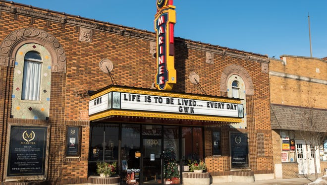 "The marquee on the front of the Mariner Theater in Marine City reads, ""Life is to be lived ... every day,"" in honor of Gary Kohs, co-owner of the theater, who died Dec. 15 at the age of 73."