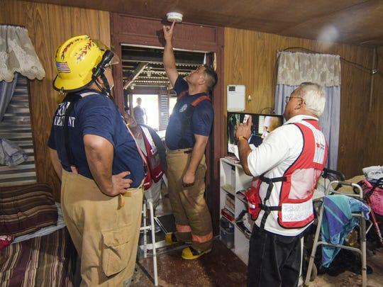 Guam Fire Department firefighter James Doyle, center,