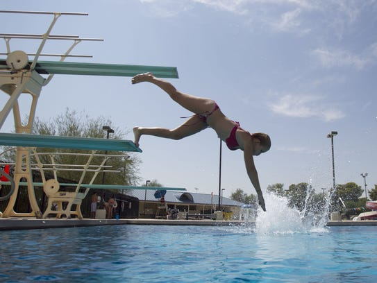 Shelby Anderson uses the diving board at the Paradise