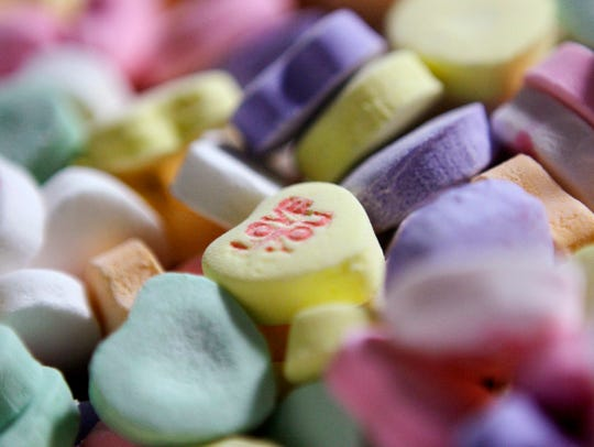 "Colored ""Sweethearts"" candy is held in bulk prior to"