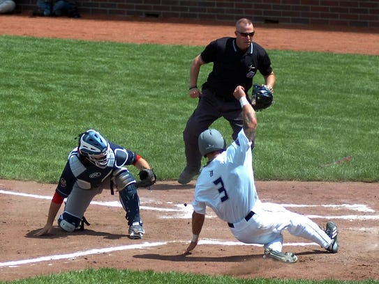 Austin Crutcher of the Unicorns is safe at home plate.