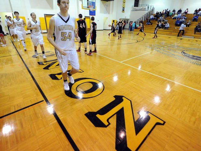 Union High School's Austin Robertson takes the floor during the game against Eastern Greene, Friday, Dec. 20, 2013, in Dugger, Ind. Union High School is set to close after a 3-2 Northeast School Corp. school board vote.
