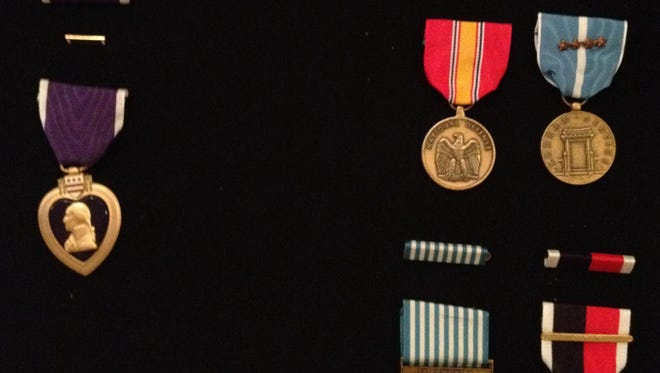 A few of Louis Gabordi's medals, including his Purple Heart.