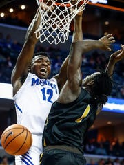 Memphis forward Victor Enoh (left) dunks over Wichita State defender Zach Brown (right) during second half action at the FedExForum in Memphis Tenn., Tuesday, February 6, 2018.