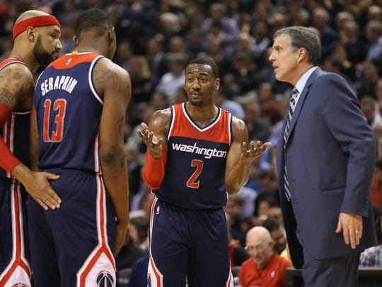 Washington Wizards point guard John Wall (2) reacts after a missed play as head coach Randy Wittman looks on.