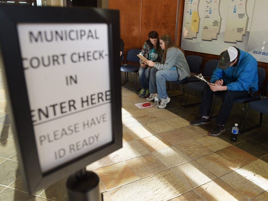 Carrie Roth, from left, Crystal Lee and Randall Cain fill out paperwork at the Fort Collins Municipal Court on Thursday, April 6, 2017.
