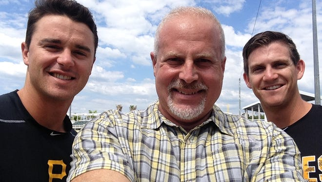 Kevin Kramer, left, and Kevin Newman, right, pose for a selfie with The News-Press staff writer David Dorsey.