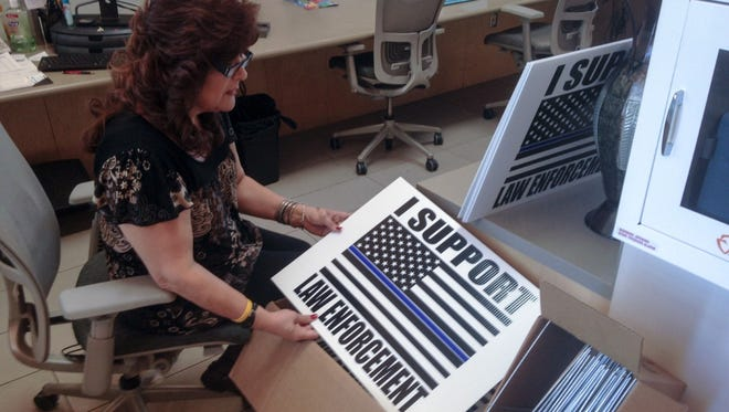 The city of Las Cruces has an additional 500 yard signs thanking law enforcement available to the public at no cost.