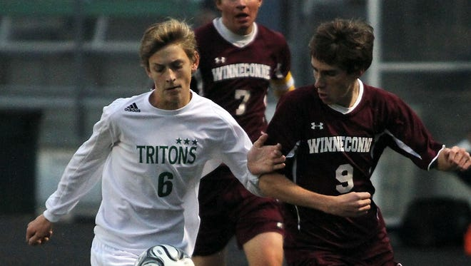 Notre Dames' Sam Wagner (6) tries to push off Winneconne's Jacob Brazee (9) in his pursuit for the ball Thursday at the WIAA Soccer Division 3 Sectional Semi-Final in Green Bay.