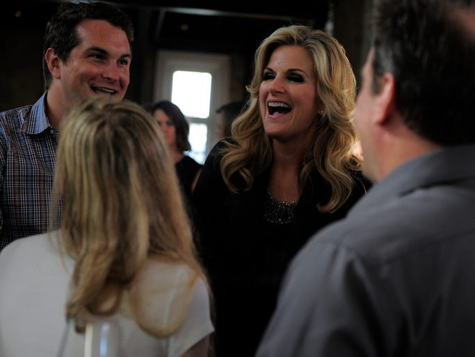 Trisha Yearwood shares a laugh with guests at a party announcing her new album and record deal Tuesday Aug. 19, 2014, in Nashville, Tenn.