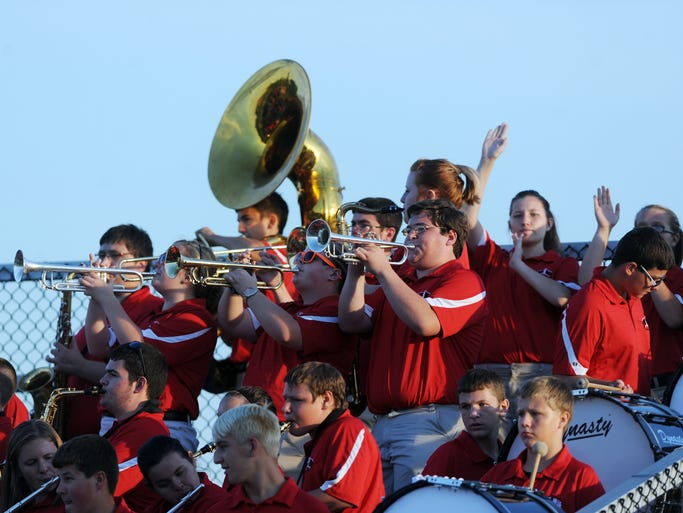 The Crookvsille High School marching band plays in the stands against Maysville.