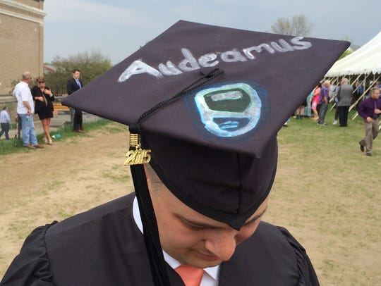 "Audeamus: ""Let Us Dare"" - the Champlain College motto,"