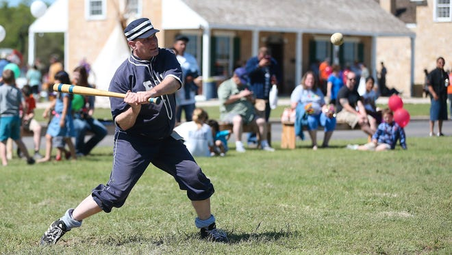 Andy Borman swings at a ball during a vintage baseball game at the 2016 Fort Concho Frontier Day.