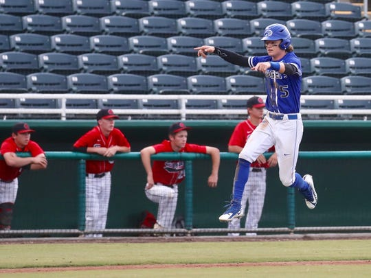 Canterbury's Danny Cunningham comes home to score a run against NFC during Thursday's Class 3A state championship.