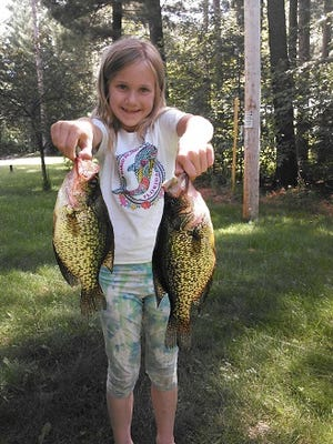 Faith Derleth with two Tomahawk area crappies.