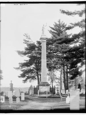 An early 1900s photo of the Ethan Allen monument at Greenmount Cemetery. It is said to be the burial place of the leader of the Green Mountain Boys. Allen said he would return as a white stallion.