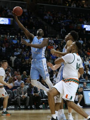 North Carolina Tar Heels forward Theo Pinson (1) drives to the basket against Miami Hurricanes center Rodney Miller Jr. (14) during the first half of a quarterfinal game of the 2018 ACC tournament at Barclays Center.