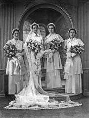 This 1937 photo shows a bride with her sisters, all of whom also wore the dress at their weddings.