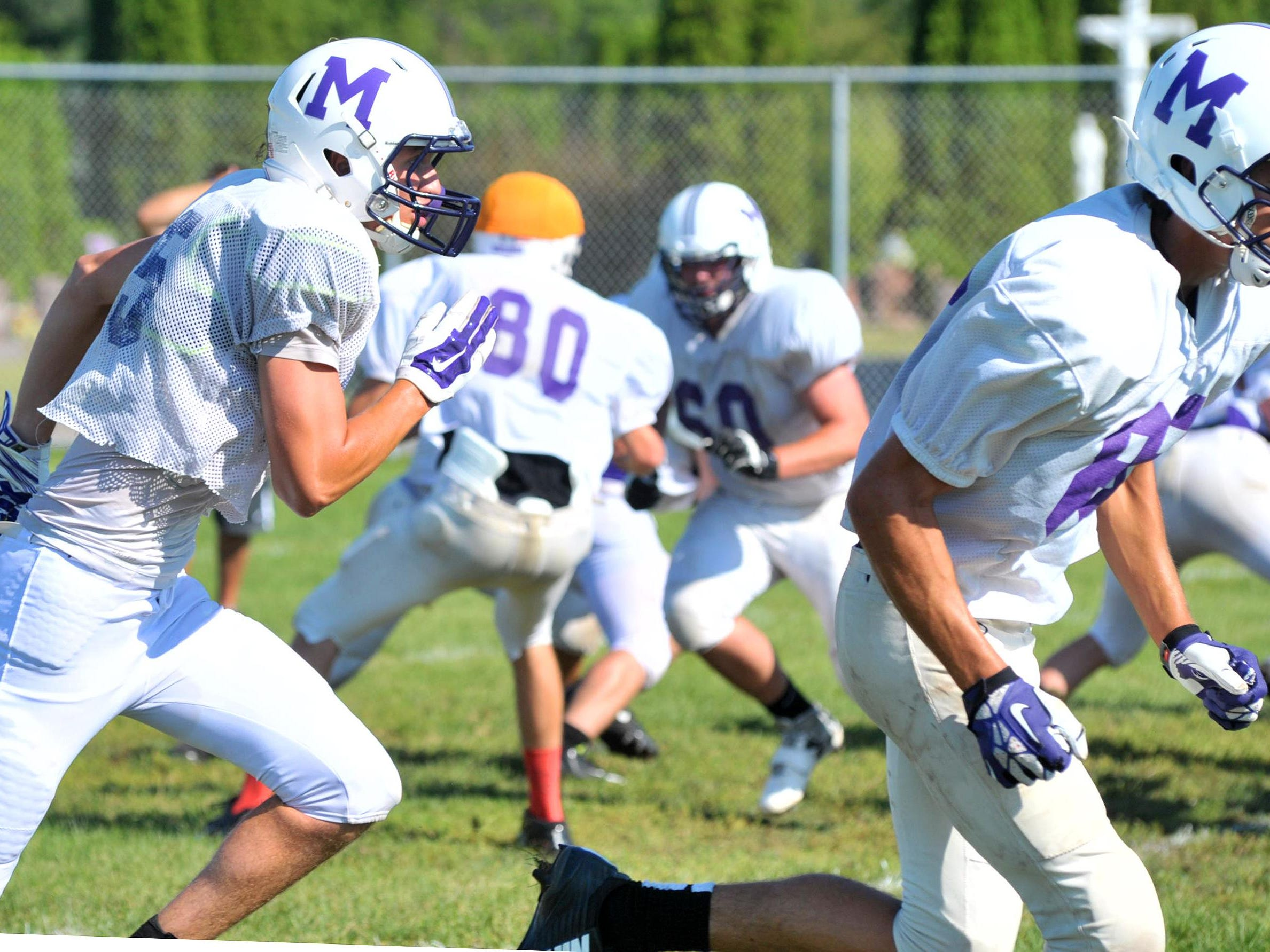 Mosinee's football team works on drill during Monday's practice at Mosinee High School football field.