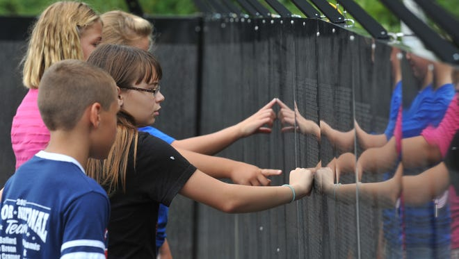 During the 2011 Richmond visit of The Wall that Heals, many area students made field trips to Veterans Memorial Park. The wall will be in Richmond Wednesday through Sunday.