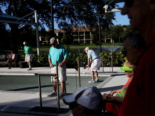Spectators and competitors sit along the sidelines during a bocce ball competition at Bentley Village in Naples in October.