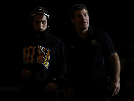 Iowa's Spencer Lee and head coach Tom Brands stand together during team introductions before their dual against Michigan State at Carver-Hawkeye Arena on Friday, Jan. 5, 2018.