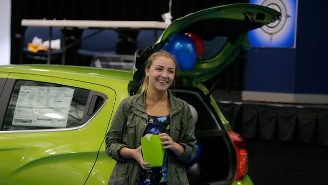 Tanya Krelik, 17, of Toms River High School North, one of six students who had their name drawn for a chance to win a car, unlocks the trunk and wins the car during the Driven to Excellence program's Pine Belt prize drawing celebration at Pine Belt Arena in Toms River, NJ Thursday June 2, 2016. Toms River schools created the Driven to Excellence program, where a Chevy Spark car, donated by Pine Belt, will be given away to a junior or senior student who was nominated by teachers for a variety of good behaviors, including improved attendance, good grades, random acts of kindness, community service.
