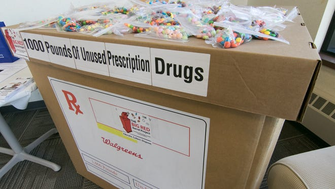 A box constructed to represent the volume required to contain 1,000 pounds of unused prescription drugs was on hand as a visual cue Thursday, Nov. 30, 2017 at an event held by the Livingston County Community Alliance celebrating the collection of 10,000 pounds of pills.