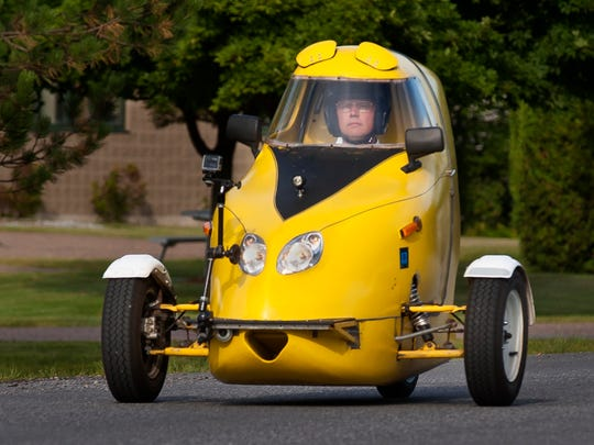 Paul Smith drives his home- made electric ScooterCar