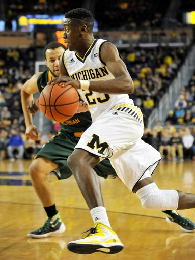 Michigan guard Caris LeVert drives to the basket in
