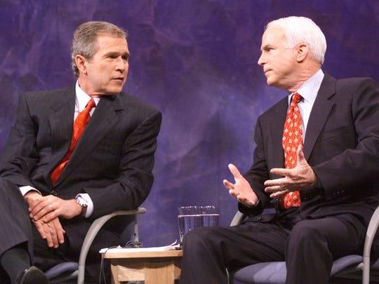 U.S. President George W. Bush and Sen. John McCain at the Iowa debate on Jan. 15, 2000.