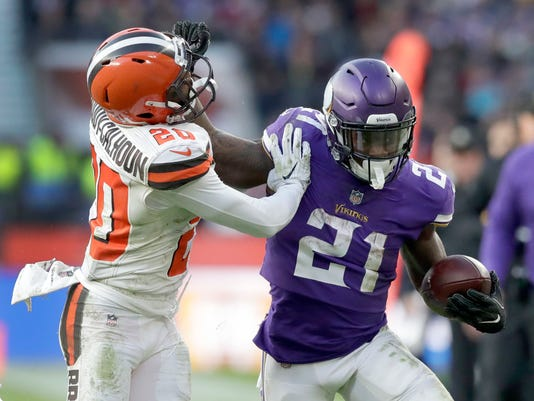 FILE - In this Sunday, Oct. 29, 2017 file photo, Minnesota Vikings running back Jerick McKinnon (21) runs with the ball as Cleveland Browns safety Briean Boddy-Calhoun (20) defends during the second half of an NFL football game at Twickenham Stadium in London. The Vikings have managed to withstand the loss of their starting quarterback and running back in the first quarter of the season with a balanced attack, quality depth and a vastly improved offensive line. Coordinator Pat Shurmur has quietly done a masterful job of keeping the offense running.(AP Photo/Matt Dunham, File)