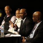 Panelists discuss questions posed by moderator James Pilcher during the Kin Killin' Kin Solutions Symposium at the Freedom Center in downtown Cincinnati on Thursday, Feb. 4, 2016. A panel of community leaders discussed possible solutions to gun violence in Cincinnati, particularly in predominantly black communities.