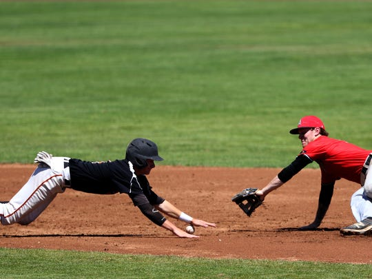 The Dirtbags' Hunter Johnson (4) slides back to second after being caught trying to steal past Gresham's Dru Fitz (5) in the Demarini Dirtbags vs Gresham Advanced Metals baseball game in the Class AAA American Legion state tournament at Volcanoes Stadium in Keizer on Friday, July 29, 2016. The Dirtbags won the game 17-6.