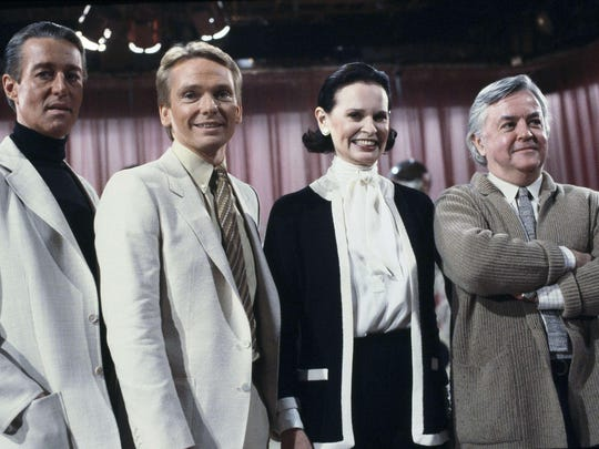"FILE - In this Feb. 3, 1981 file photo, fashion designers, from left to right: Halston; Bob Mackie; Gloria Vanderbilt and Geoffrey Beene pose on the set of the ""Love Boat"" at Warner Brothers Studio in Los Angeles, Calif. Vanderbilt, the intrepid heiress, artist and romantic who began her extraordinary life as the ""poor little rich girl"" of the Great Depression, survived family tragedy and multiple marriages and reigned during the 1970s and '80s as a designer jeans pioneer, died Monday, June 17, 2019, at the age of 95. (AP Photo/Wally Fong/File)"