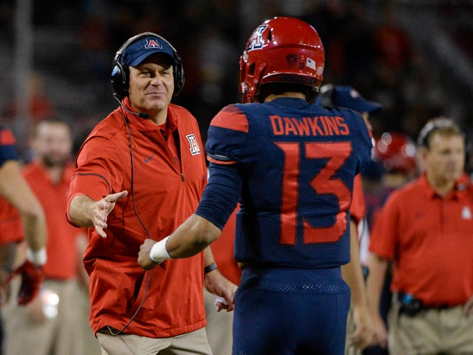 Arizona Wildcats head coach Rich Rodriguez high fives