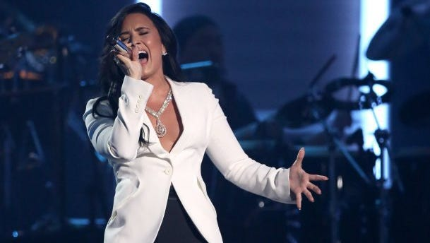 """Demi Lovato performs """"Hello"""" during a tribute to MusiCares Person of the Year honoree Lionel Richie at the 58th annual Grammy Awards on Feb. 15, 2016, in Los Angeles."""