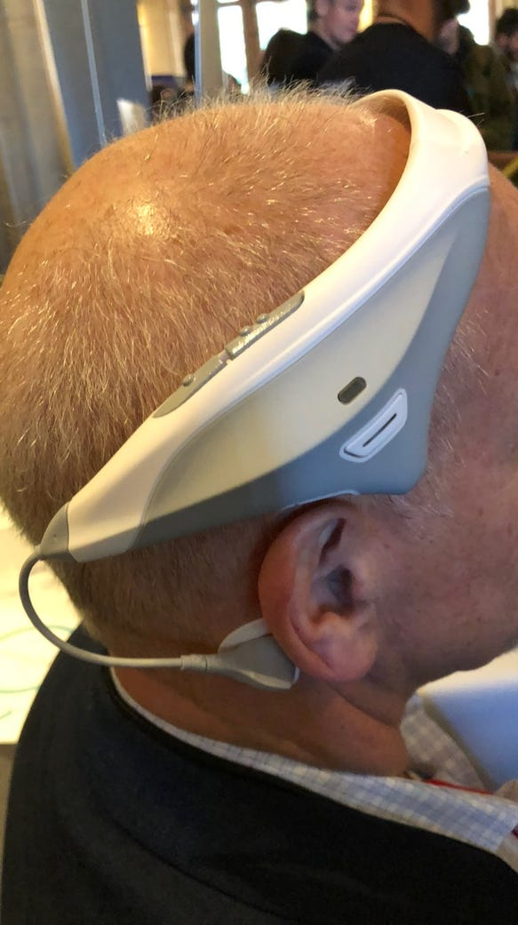 A side view of Ed Baig wearing Modius weight loss headset
