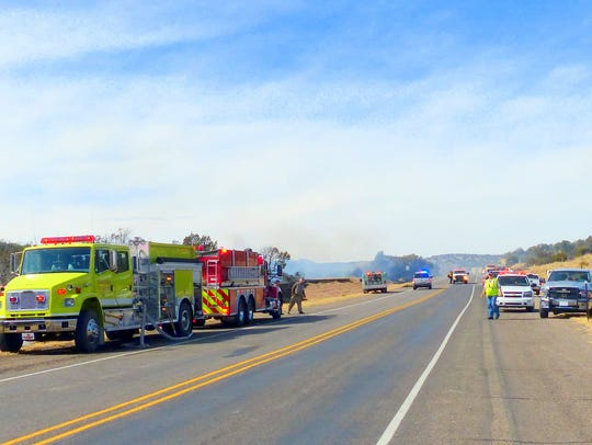 Fire fighting units lined both sides of U.S. 380 west
