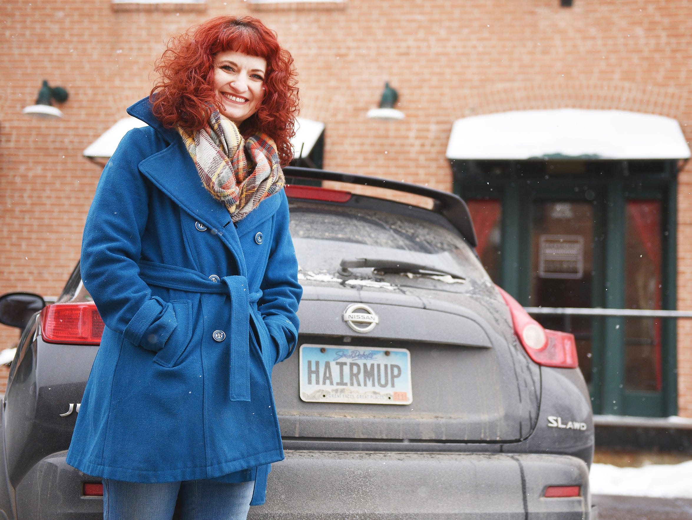 Angelique Verver shows off her license plate that reads