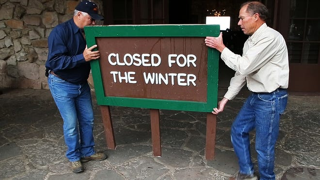 """Each Oct. 15, workers put out the """"closed"""" sign in front of the Grand Canyon Lodge North Rim."""