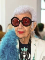 FILE - In this Sept. 16, 2015, file photo, Iris Apfel attends New York Fashion in New York. Apfel will be a celebrity guest on a fashion-themed trans-Atlantic crossing aboard the Queen Mary 2 ocean liner, departing England Aug. 31, arriving New York Sept. 7.
