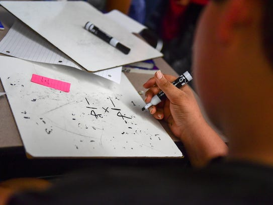 A sixth-grader works on a fraction problem on Monday,