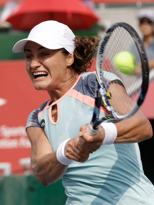 Monica Niculescu of Romania returns a shot against Zhang Shuai of China during their semi final match of the Korea Open tennis championship at Olympic Park in Seoul, South Korea, Saturday, Sept. 24, 2016. (AP Photo/Ahn Young-joon)