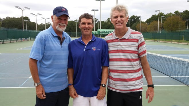 Pensacola's Terry Thrash, center, was named the 2015 USTA/Florida Volunteer of the Year. Roger Scott's Bruce Caton, left, and The Club II's Brian Sakey proudly stand with Thrash, who has helped tennis grow in the area and throughout the state.