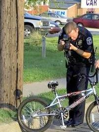 Metro Officer Ray Sutherland investigates accident involving bicycle